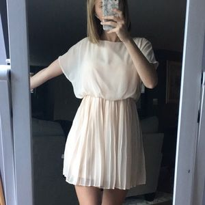 cream colored dress.